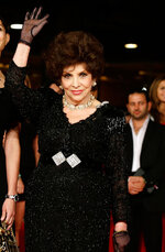 FILE - In this Nov. 16, 2012 file photo, actresses Gina Lollobrigida poses for photographers as they arrive for the screening of a documentary on Miss Italy during the 7th edition of the Rome International Film Festival in Rome. Lollobrigida turns 93 on July. 4. (AP Photo/Gregorio Borgia, File)