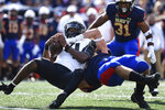 Air Force quarterback Haaziq Daniels left, is tackled by Navy defensive end Jacob Busic (95) during the first half of an NCAA college football game, Saturday, Sept. 11, 2021, in Annapolis, Md. (AP Photo/Terrance Williams)