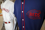 The Cincinnati Reds baseball team uniforms for the 2019 season are displayed at Great American Ball Park, Monday, Jan. 7, 2019, in Cincinnati. The Reds will play games in 15 sets of throwback uniforms, including navy blue and a