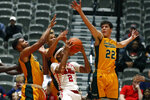 Southeastern Louisiana forward Nick Caldwell (22) and teammates defend against a shot by Mississippi guard Devontae Shuler (2) during the second half of an NCAA college basketball game, Saturday, Dec. 21, 2019, in Jackson, Miss. Mississippi won 83-76.(AP Photo/Rogelio V. Solis)