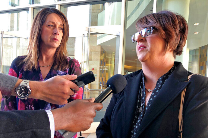 Michelle Balogh, right, and Kelly Willis speak to reporters Wednesday, Jan. 8, 2020 following the sentencing of the Mexican man who killed their brother, U.S. Border Patrol agent Brian Terry, in December 2010, outside court in Tucson, Ariz.  Heraclio Osorio-Arellanes, convicted of murder in the fatal shooting of Border Patrol agent Brian Terry, in a case that exposed a botched federal gun program known as