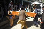 Afghans carry the body of a woman who was killed by gunmen in the city of Jalalabad, east of Kabul, Afghanistan, Tuesday, March 30, 2021. Attackers on Tuesday gunned down three women working to administer the anti-polio vaccine in eastern Afghanistan, officials said, a day after authorities launched a new campaign against the crippling children's disease. (AP Photo)
