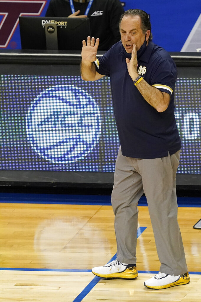 Notre Dame head coach Mike Brey directs his team during the first half of an NCAA college basketball game against Wake Forest in the first round of the Atlantic Coast Conference tournament in Greensboro, N.C., Tuesday, March 9, 2021. (AP Photo/Gerry Broome)