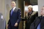 Palestinian President Mahmoud Abbas, center, and former Israeli Prime Minister Ehud Olmert, left, arrive for a news conference in New York, Tuesday, Feb. 11, 2020. (AP Photo/Seth Wenig)