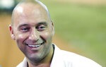 Miami Marlins baseball team CEO Derek Jeter smiles as he speaks to members of the media, Monday, Feb. 11, 2019, in Miami. Jeter is entering his second season as CEO of the Marlins, who remain in the throes of a rebuilding project. (AP Photo/Wilfredo Lee)