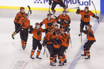 Philadelphia Flyers' Claude Giroux, center, celebrates with teammates after he scored against the Pittsburgh Penguins during overtime of an NHL Stadium Series hockey game at Lincoln Financial Field, Saturday, Feb. 23, 2019, in Philadelphia. Philadelphia won 4-3. (AP Photo/Matt Rourke)