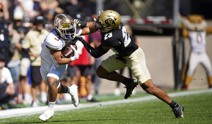 Minnesota running back Treyson Potts, left, is stopped by Colorado safety Isaiah Lewis in the first half of an NCAA college football game Saturday, Sept. 18, 2021, in Boulder, Colo. (AP Photo/David Zalubowski)