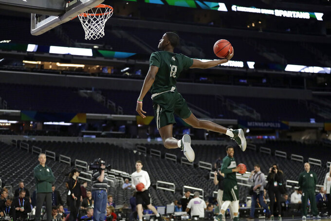Michigan State forward Gabe Brown dunks the ball during a practice session for the semifinals of the Final Four NCAA college basketball tournament, Friday, April 5, 2019, in Minneapolis. (AP Photo/Jeff Roberson)