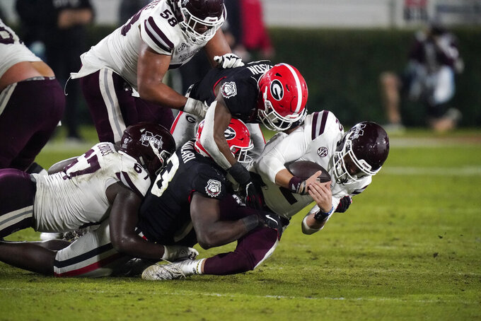 Georgia linebacker Azeez Ojulari (13) and a teammate bring down Mississippi State quarterback Will Rogers (2) during the second half of an NCAA college football game Saturday, Nov. 21, 2020, in Athens, Ga. (AP Photo/Brynn Anderson)