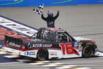 Austin Hill celebrates winning a NASCAR Truck Series race at Michigan International Speedway in Brooklyn, Mich., Saturday, Aug. 10, 2019. (AP Photo/Paul Sancya)