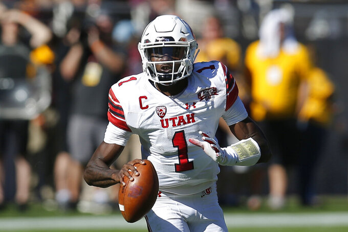 FILE - In this Nov. 3, 2018, file photo, Utah quarterback Tyler Huntley (1) is shown in the first half during an NCAA college football game against Arizona State, in Tempe, Ariz. No. 14 Utah heads into the 100th edition of the Holy War rivalry with BYU sporting a new-look offense headlined by a familiar playmaker. (AP Photo/Rick Scuteri, File)
