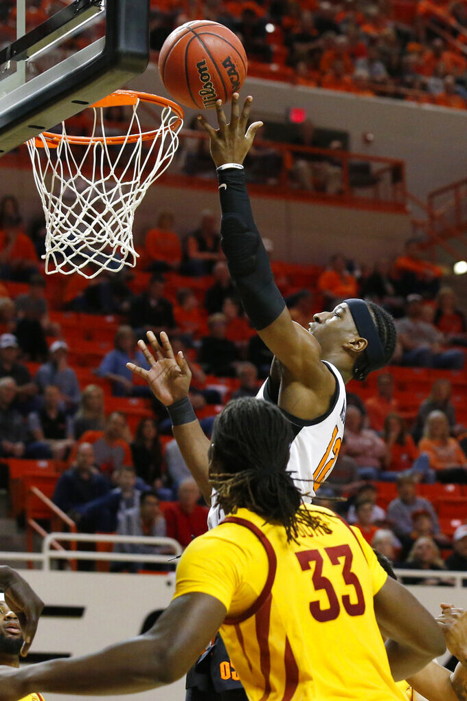 Oklahoma State forward Cameron McGriff (12) shoots in front of Iowa State forward Solomon Young (33) in the first half of an NCAA college basketball game in Stillwater, Okla., Saturday, Feb. 29, 2020. (AP Photo/Sue Ogrocki)