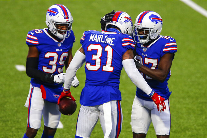 Buffalo Bills' Dean Marlowe (31) celebrates with teammates Tre'Davious White (27) and Levi Wallace (39) after recovering a fumble by New England Patriots' Cam Newton (1) during the second half of an NFL football game Sunday, Nov. 1, 2020, in Orchard Park, N.Y. The Bills won 24-21. (AP Photo/John Munson)