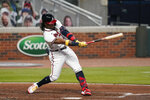 Atlanta Braves' Ronald Acuna Jr., strikes out in the fourth inning of a baseball game against the Miami Marlins on Tuesday, Sept. 22, 2020, in Atlanta. (AP Photo/Brynn Anderson)