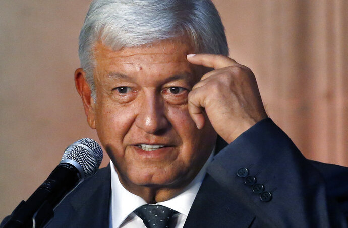 Mexico's President-elect Andres Manuel Lopez Obrador speaks to reporters after meeting with Mexico's President Enrique Pena Nieto at the National Palace in Mexico City, Tuesday, July 3, 2018. The president-elect met with the current leader to discuss his transition to office in December, aiming to ensure an orderly transfer of power after a heated and polarizing campaign. (AP Photo/Marco Ugarte)