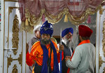 Sikh pilgrims attend the Vasakhi festival, at the shrine of Gurdwara Punja Sahib, the second most sacred place for Sikhs, in Hasan Abdal, some 50 kilometers (31 Miles) from Islamabad, Pakistan, Sunday, April 14, 2019. Thousands of Sikh pilgrims arrived from neighboring India and other countries to attend the harvest festival that is regionally known by many names and marks the Solar New Year. (AP Photo/Anjum Naveed)
