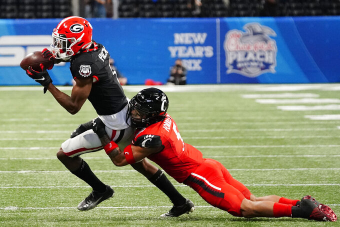 Georgia wide receiver George Pickens (1) runs against Cincinnati safety Darrick Forrest (5) during the first half of the Peach Bowl NCAA college football game, Friday, Jan. 1, 2021, in Atlanta. (AP Photo/Brynn Anderson)