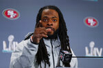 San Francisco 49ers cornerback Richard Sherman gestures as he speaks during a media availability, Wednesday, Jan. 29, 2020, in Miami, for the NFL Super Bowl 54 football game against the Kansas City Chiefs. (AP Photo/Wilfredo Lee)