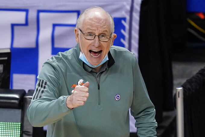 Miami head coach Jim Larranaga directs his team during the second half of an NCAA college basketball game against Georgia Tech in the quarterfinal round of the Atlantic Coast Conference tournament in Greensboro, N.C., Thursday, March 11, 2021. (AP Photo/Gerry Broome)