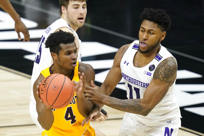 Minnesota's Jamal Mashburn Jr. (4) makes a pass against Northwestern's Anthony Gaines (11) during the second half of an NCAA college basketball game at the Big Ten Conference tournament, Wednesday, March 10, 2021, in Indianapolis. (AP Photo/Darron Cummings)