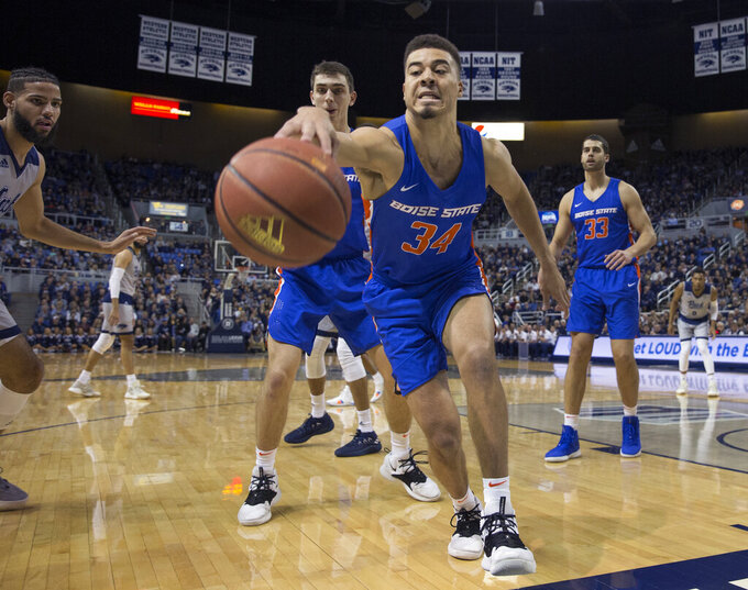 Boise State guard Alex Hobbs (34) tries to save the ball in the first half of an NCAA college basketball game against Nevada in Reno, Nev., Saturday, Feb. 2, 2019. (AP Photo/Tom R. Smedes)