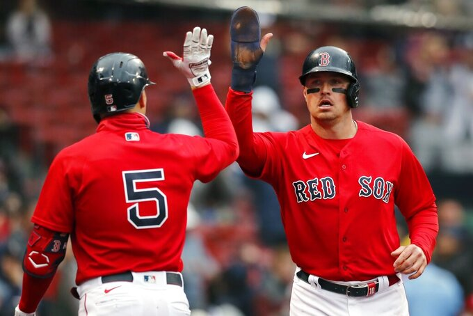 Boston Red Sox's Hunter Renfroe celebrates with Enrique Hernandez (5) after scoring on a single by Kevin Plawecki during the fourth inning of a baseball game against the Miami Marlins, Saturday, May 29, 2021, in Boston. (AP Photo/Michael Dwyer)