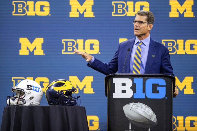 FILE - Michigan head coach Jim Harbaugh speaks during an NCAA college football news conference at the Big Ten Conference media days in Indianapolis, in this Thursday, July 22, 2021, file photo. Jim Harbaugh and the Michigan Wolverines are looking forward to a fresh start, opening against Western Michigan at home, after a two-win, pandemic-shortened season. (AP Photo/Doug McSchooler, File)