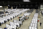 In this April 5, 2020 photo, rows of patient beds are shown at a military field hospital at the CenturyLink Field Event Center in Seattle. Washington Gov. Jay Inslee said Wednesday, April 8, 2020, that the field hospital will be returned to the Federal Emergency Management Agency so it can be deployed to another state facing more of a crisis from the outbreak of the coronavirus. (AP Photo/Ted S. Warren)
