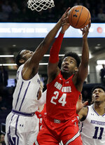 Ohio State forward Andre Wesson, right, and Northwestern forward Vic Law, left, reach for a rebound during the first half of an NCAA college basketball game Wednesday, March 6, 2019, in Evanston, Ill. (AP Photo/Nam Y. Huh)