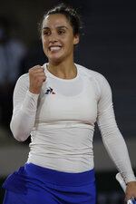 Italy's Martina Trevisan clenches her fist after scoring a point against Cori Gauff of the U.S. in the second round match of the French Open tennis tournament at the Roland Garros stadium in Paris, France, Wednesday, Sept. 30, 2020. (AP Photo/Alessandra Tarantino)