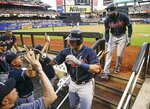 Atlanta Braves' Austin Riley, center, celebrates with teammates after hitting a two-run home run during the second inning of a baseball game against the New York Mets, Friday, June 28, 2019, in New York. (AP Photo/Frank Franklin II)