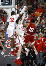 Indiana's Rob Phinisee, right, tries to shoot over Ohio State's E.J. Liddell, left, and Kyle Young during the second half of an NCAA college basketball game Saturday, Feb. 1, 2020, in Columbus, Ohio. Ohio State beat Indiana 68-59. (AP Photo/Jay LaPrete)