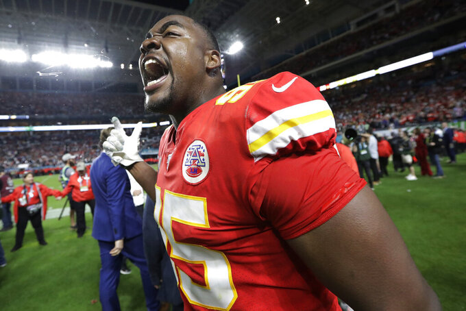 Kansas City Chiefs' Chris Jones (95) celebrates during the second half of the NFL Super Bowl 54 football game against the San Francisco 49ers Sunday, Feb. 2, 2020, in Miami Gardens, Fla. The Kansas City Chiefs won 31-20. (AP Photo/Mark Humphrey)