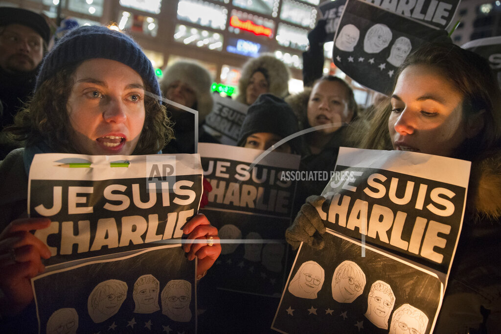 France Newspaper Attack NY Rally