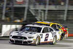 Brad Keselowski (2) passes Kyle Busch during a NASCAR Cup Series auto race Saturday, Aug. 17, 2019, in Bristol, Tenn. (AP Photo/Wade Payne)