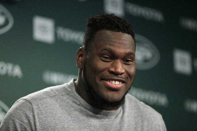 FILE - In this June 4, 2019, file photo, New York Jets offensive guard Kelechi Osemele speaks to reporters at the team's NFL football training facility in Florham Park, N.J. The Kansas City Chiefs have had two players opt out of the upcoming season because of COVID-19. But with the signing of veteran guard Kelechi Osemele, and some key offseason acquisitions at both spots, there may be no positions for which the Chiefs are better able to absorb those losses as they head into training camp. (AP Photo/Julio Cortez, File)