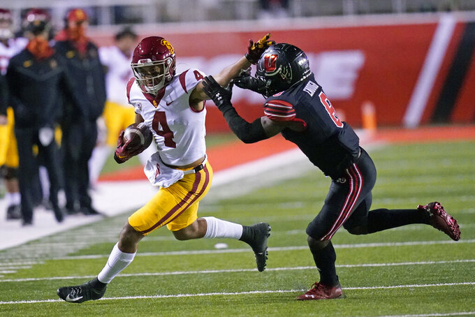 Utah cornerback Clark Phillips III (8) tackles Southern California wide receiver Bru McCoy (4) during the first half during an NCAA college football game Saturday, Nov. 21, 2020, in Salt Lake City. (AP Photo/Rick Bowmer)