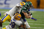 Eastern Michigan wide receiver Hassan Beydoun (16) is brought down by Pittsburgh linebacker Cam Bright (38) and defensive back Vince Calhoun (3) during the second half of the Quick Lane Bowl NCAA college football game, Thursday, Dec. 26, 2019, in Detroit. (AP Photo/Carlos Osorio)