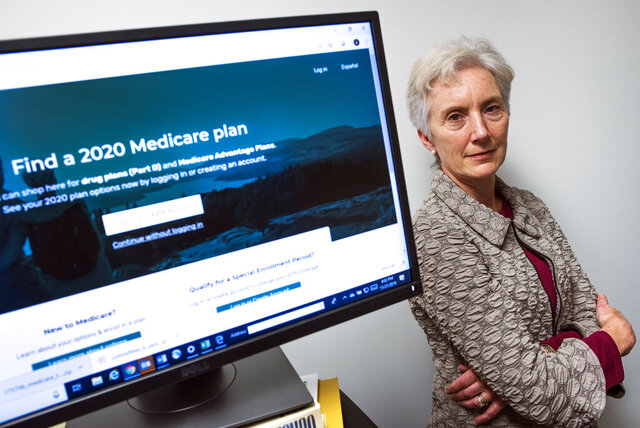 Ann Kayrish, Medicare expert for the National Council on Aging (NCOA) works in her office on President Trump's administration's new and highly touted online tool for seniors to find Medicare prescription drug plans, in Arlington, Va., Thursday, Nov. 21, 2019. The online tool has problems providing key information. (AP Photo/Cliff Owen)