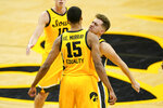 Iowa forward Keegan Murray (15) celebrates with teammate Jordan Bohannon, right, after making a basket during the second half of an NCAA college basketball game against North Carolina, Tuesday, Dec. 8, 2020, in Iowa City, Iowa. Iowa won 93-80. (AP Photo/Charlie Neibergall)