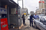 FILE - This file photo released on April 7, 2019, by the Syrian official news agency SANA, shows a worker filling a pickup at a gas station, in Homs, Syria. As a fuel shortage crisis deepens in government-held areas of Syria, Cabinet ministers huddled in televised meetings to reassure the public they are searching for solutions. New rationing measures were rolled out, and government officials held talks with allies in Iran and Russia to explore options for the crisis aggravated by U.S. sanctions on Damascus and Tehran. (SANA via AP, File)