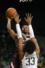 Texas State guard Nijal Pearson shoots over Baylor forward Freddie Gillespie (33) during the first half of an NCAA college basketball game in Waco, Texas, Friday, Nov. 15, 2019. (AP Photo/Tony Gutierrez)