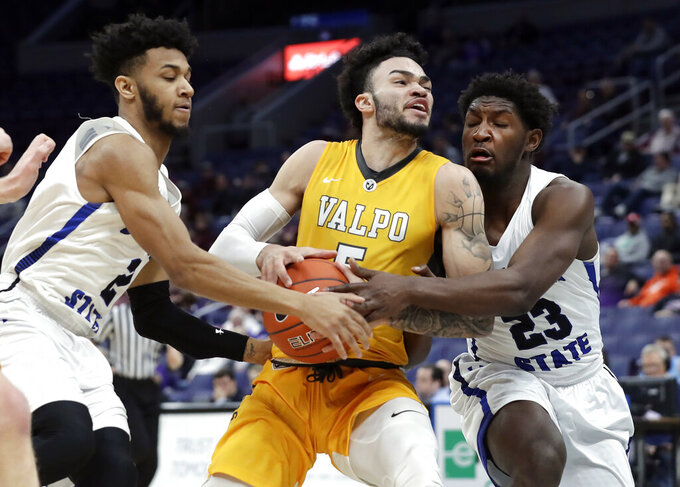 Valparaiso's Markus Golder, center, is fouled on his way to the basket by Indiana State's Jordan Barnes, left, as Indiana State's De'Avion Washington, right, helps defend during the first half of an NCAA college basketball game in the first round of the Missouri Valley Conference men's tournament Thursday, March 7, 2019, in St. Louis. (AP Photo/Jeff Roberson)