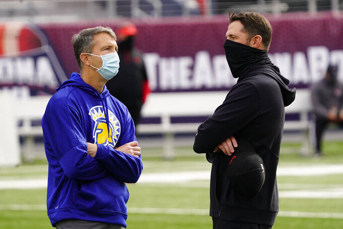 San Jose State head coach Brent Brennan, left, talks to Ball State head coach Mike Neu before the Arizona Bowl NCAA college football game, Thursday, Dec. 31, 2020, in Tucson, Ariz. (AP Photo/Rick Scuteri)