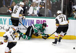 Dallas Stars center Andrew Cogliano (17) has the puck stripped away Vegas Golden Knights' Colin Miller (6) and William Karlsson (71) as Reilly Smith (19) watches in the third period period of an NHL hockey game in Dallas, Friday, March 15, 2019. (AP Photo/Tony Gutierrez)