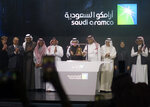 Saudi Arabia's state-owned oil company Saudi Armco and stock market officials celebrate during the official ceremony marking the debut of Aramco's initial public offering (IPO) on the Riyadh's stock market, in Riyadh, Saudi Arabia, Wednesday, Dec. 11, 2019. (AP Photo/Amr Nabil)