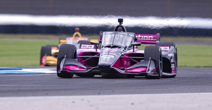 Helio Castroneves, of Brazil, drives along the course during a practice session for the IndyCar auto race at Indianapolis Motor Speedway, Friday, Aug. 13, 2021, in Indianapolis. (AP Photo/Doug McSchooler)