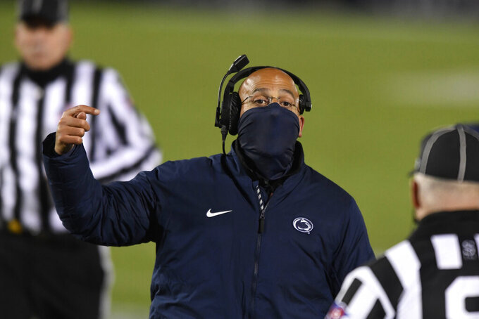 Penn State head coach James Franklin talks with an official during the fourth quarter of the team's NCAA college football game against Ohio State in State College, Pa., on Saturday, Oct. 31, 2020. Ohio State won 38-25. (AP Photo/Barry Reeger)