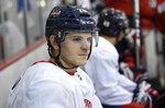 Washington Capitals' Nic Dowd sits on the bench before taking the ice at NHL hockey training camp, Friday, Sept. 14, 2018, in Arlington, Va. (AP Photo/Nick Wass)