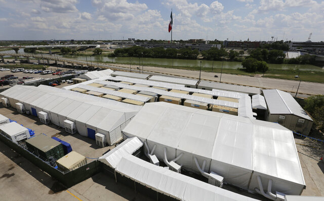 FILE - In this Sept. 17, 2019, file photo, is the Migration Protection Protocols Immigration Hearing Facility, a new tent court facility made up of tents and portable pods along the Rio Grande in Laredo, Texas. Law groups representing immigrants say the immigration court system under the Trump administration has become a